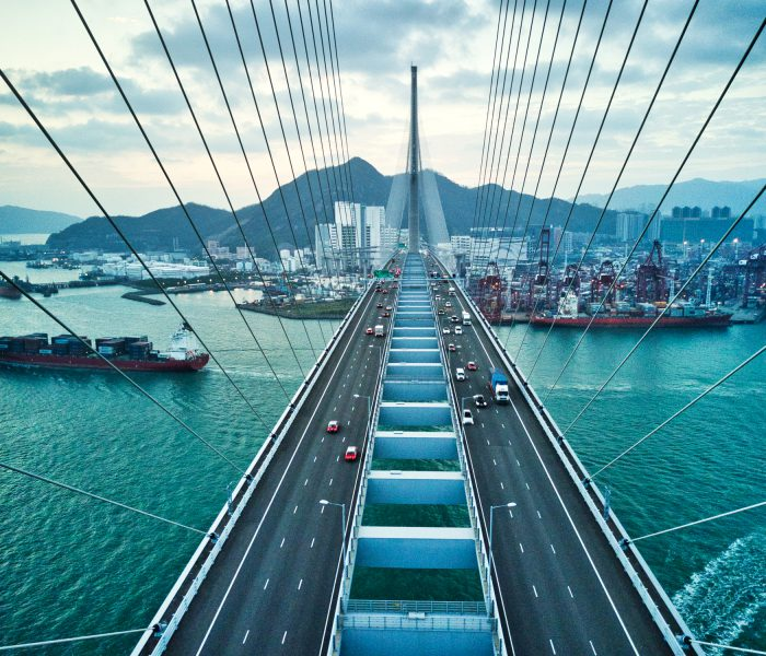 Bridge in Hong Kong and Container Cargo freight ship